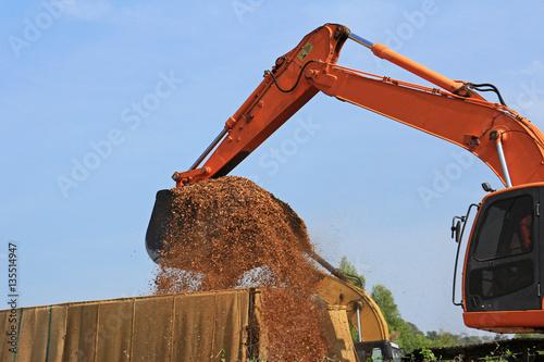 Fototapeta  Backhoe Loading Woodchip into Truck
