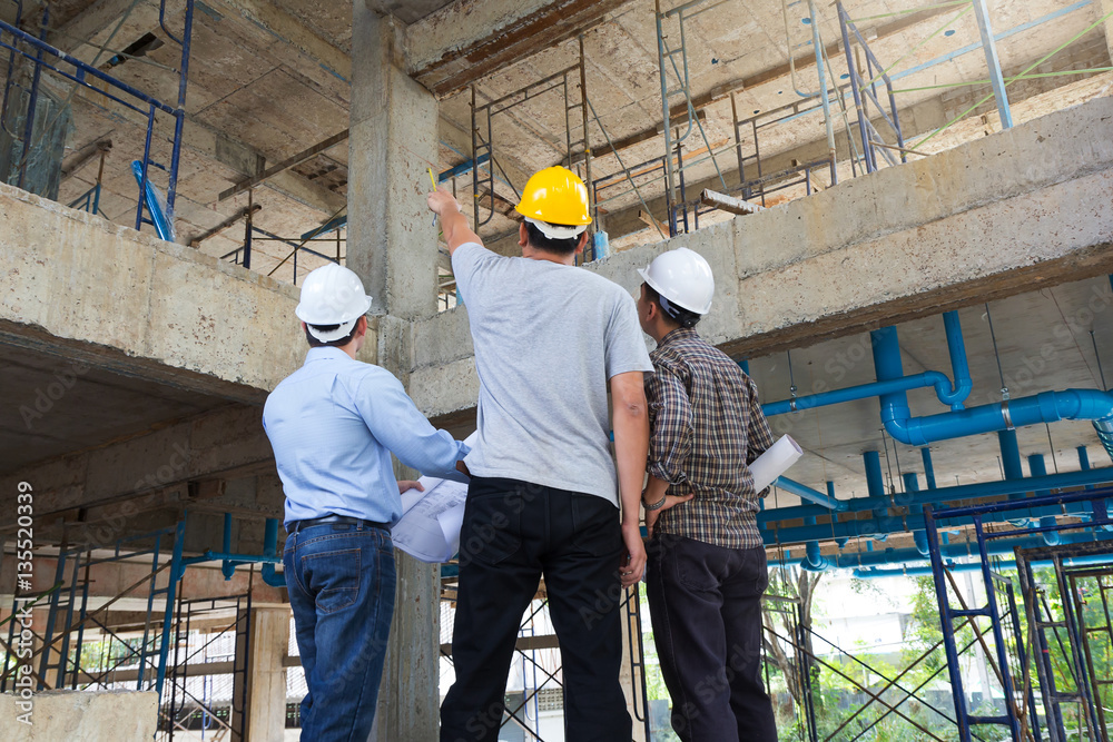 Fototapeta Construction concepts, Engineer and Architect working at Construction Site with blueprint