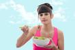young brunette woman eats salad