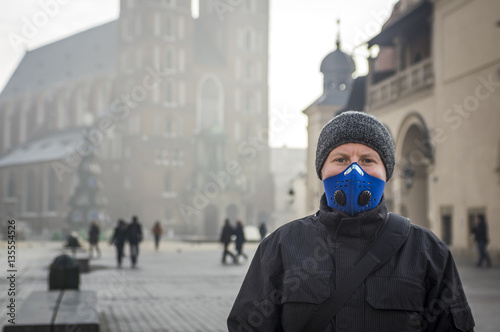 Man using a mask,  protecting himself from smog Poster