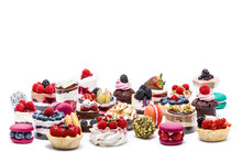 Selection Of Miniature Cakes, Macrons, Cupcakes And Treats