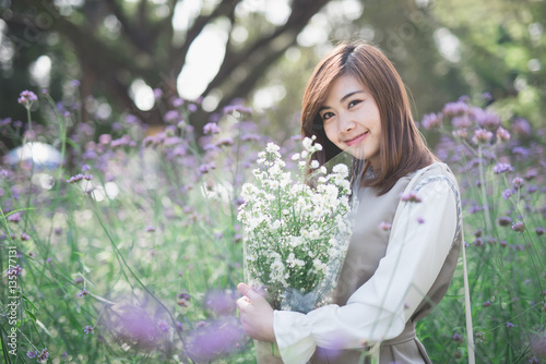 Fototapety, obrazy: young asia woman with flowers