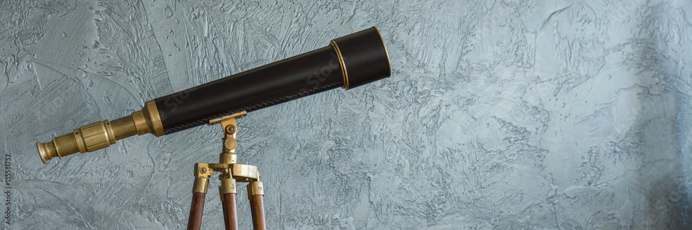 Fototapety, obrazy: Antique telescope and grey wall