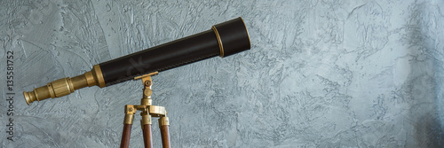 Fototapeta Antique telescope and grey wall obraz