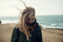 Portrait Of Woman At Beach With Windswept Hair, Long Island, New York, United States Of America