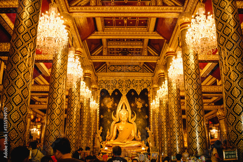 Gold sculpture of the Buddha statue, known as Phra Phuttha Chinnarat at Wat Phra Sri Rattana Mahathat temple and most beautiful buddha in Thailand Canvas Print