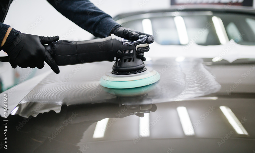 Fototapety, obrazy: Car detailing - Hands with orbital polisher in auto repair shop.