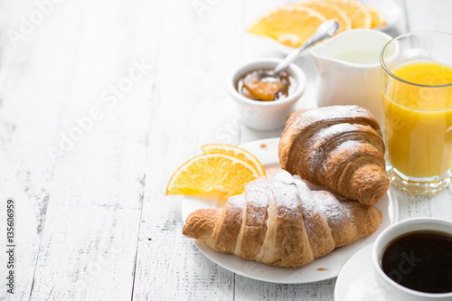 Fotomural Croissant jam coffee orange juice at white wooden table