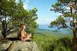 woman meditating at mountains