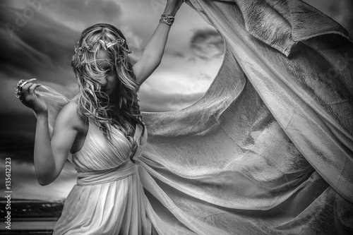 Obraz na plátně  Virgin greek virgin, beautiful blond woman in white silk dress i