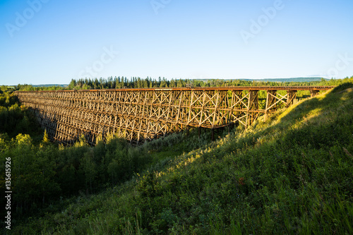 Fotografie, Tablou Sunrise on Pouce Coupe historic railroad trestle