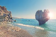 Heart Shaped Rock On Beach On Sunny Summer Day