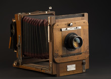 Old Photographic Camera On A Dark Gray Background 1