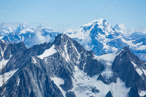 Fotobehang Alpen Ice, snow, and glaciers cling to the sides of Mont Blanc in the french Alps