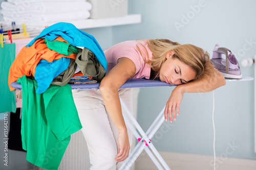 Tired Woman Sleeping On Ironing Board Fototapeta