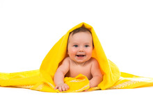 Newborn Baby Lying Down And Smiling In A Yellow Towel