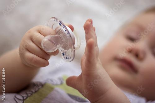 Fotografia, Obraz  baby with a nipple