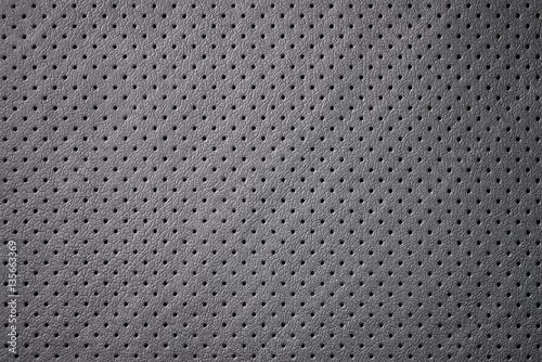 Valokuva  Car perforated leather background. Interior detail. Macro photo.