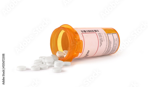 Fotografering  white pills in yellow bottle isolated