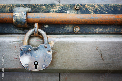 Old rusty aged padlock on the door