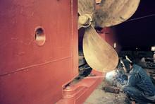 Welder Man Working In Ship Yard,color Toned.