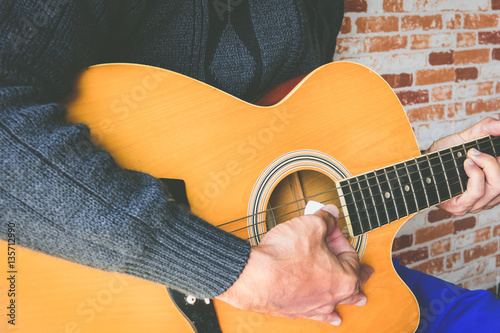 Fotografie, Obraz  Close up a man playing guitar