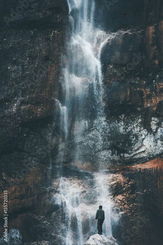 Fototapeta Waterfall Landscape and Traveler enjoying waterfall view Travel Lifestyle adventure concept active vacations into the wild harmony with nature obraz na płótnie