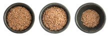 Collection Of Raw Dry Flax Seeds Or Linseeds Heap In Black Iron Bowl