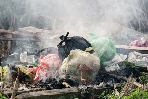 Fotografiet  Plastic waste and rubbish open burning