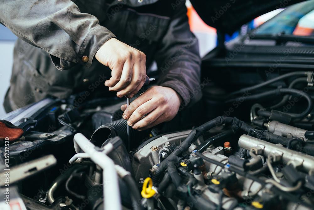 Fototapety, obrazy: Auto mechanic repairing car. Selective focus.