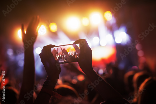 Crowd at concert recording atmosphere with their smart phones. Canvas Print