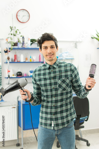 Fotografie, Obraz  Professional male hairdresser with comb and hairdryer at hair salon