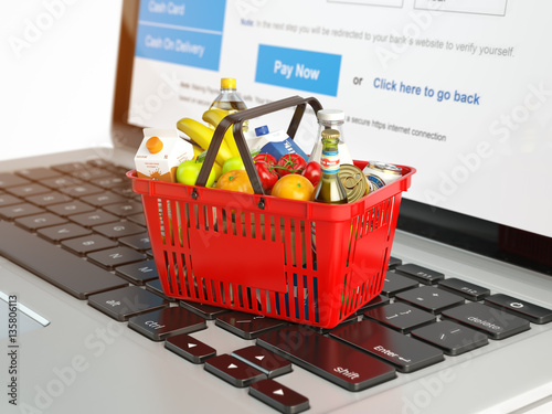 Poster Shopping basket with variety of grocery products ion laptop keyb