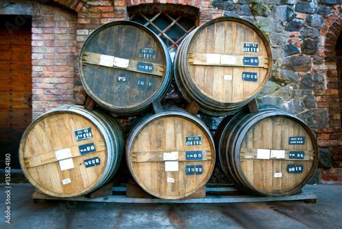 Five Vintage Wooden Wine Storage Barrels Stacked