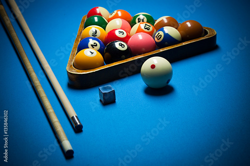 Fotografie, Obraz  Photo fragment of the blue pool billiard game with cue. Pool bil