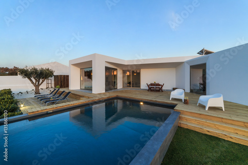 Fotografie, Obraz  Modern house with garden swimming pool and wooden deck