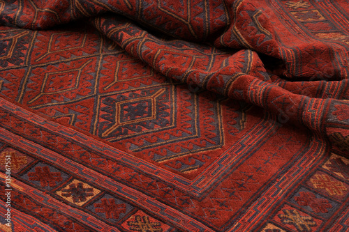 Fotografie, Obraz  Close up of a hand woven and knotted afghan berjesta mashwani kilim rug