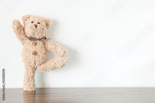 Fototapeta  Teddy bear is an exercise with yoga and warm body