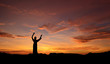 Statue of Jesus over beautiful sunset