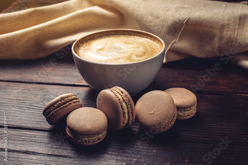 Aluminium Prints Macarons Flavored coffee cappuccino with macarons and cinnamon. The perfect Breakfast