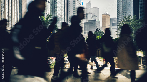 Commuters in Wan Chai using a Pedestrian crossing in the rush hour over Gloucest Canvas Print