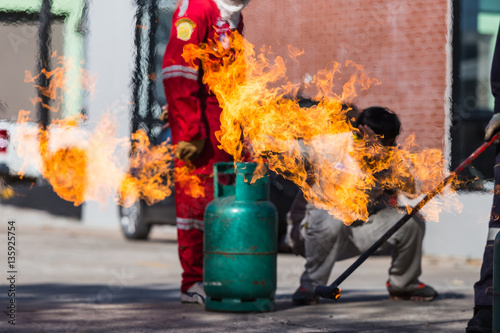 Photo  Firefighters extinguish a fire at a demonstration on the gas tan