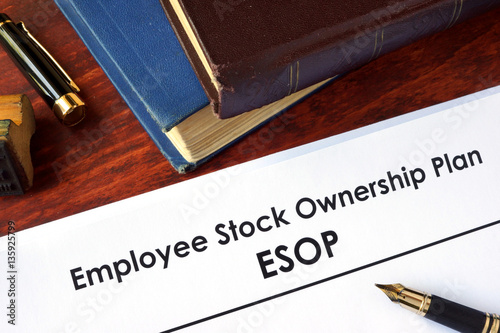 Fotografie, Obraz  Papers with Employee Stock Ownership Plan (ESOP) on a table.
