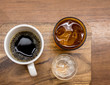 drip coffee, serve with ice water and soda shot on wooden plate