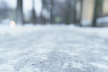 Low Angle Shot Of Town Sidewalk In Winter, Natural Blur