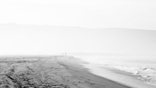 Beach Scene In Black And White With Mist And People