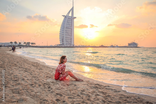 Woman Sitting On The Beach At Sunset 1 Wallpaper Mural