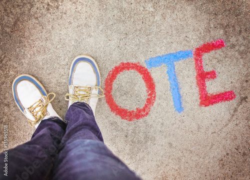 a pair of shoes in the form of the letter V for vote on a sidewalk Wallpaper Mural