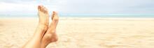 Woman Legs On The Beach
