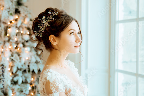 Bride. Wedding. The bride in a short dress with lace in the crow Fototapeta